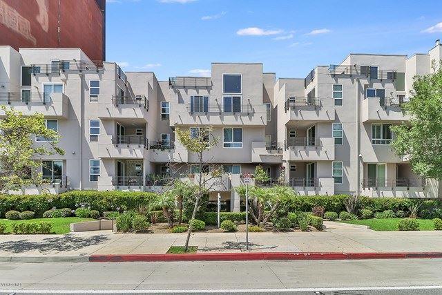 Photo of 4925 Wilshire Boulevard #103, Los Angeles, CA 90010 (MLS # 220006492)