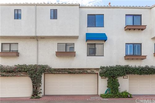 Photo of 16501 Bordeaux Lane #211, Huntington Beach, CA 92649 (MLS # LG20239493)