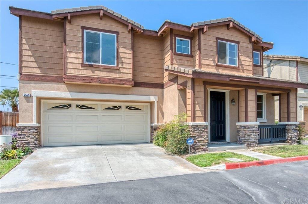 Photo of 2555 W Glen Ivy Lane Lane, Anaheim, CA 92804 (MLS # LG21159501)