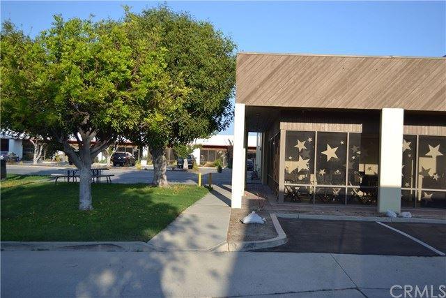 Photo of 10794 Los Vaqueros Circle, Los Alamitos, CA 90720 (MLS # PW20212502)