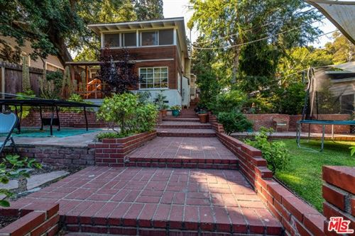 Photo of 8709 LOOKOUT MOUNTAIN Avenue, Los Angeles, CA 90046 (MLS # 19500504)