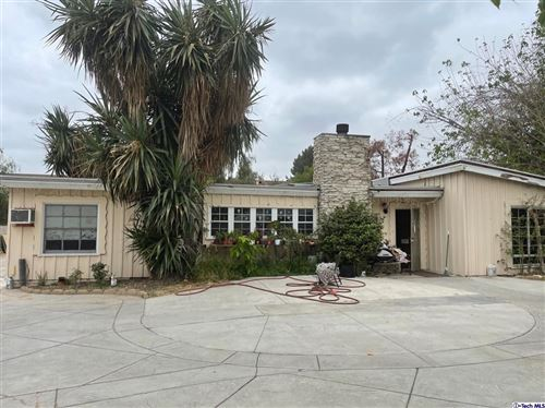 Photo of 8561 Orion Avenue, North Hills, CA 91343 (MLS # 320007505)