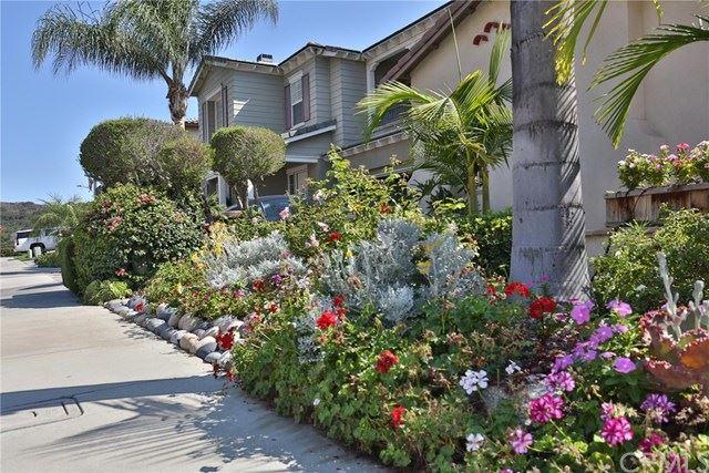 Photo of 31 Arbor Walk Lane, Rancho Santa Margarita, CA 92688 (MLS # OC21042514)