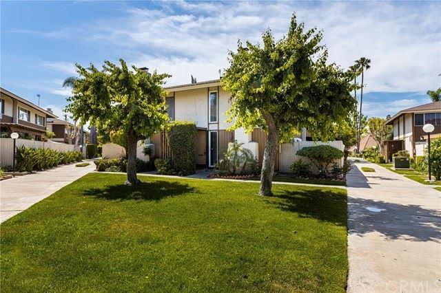 Photo of 15500 Tustin Village Way #113, Tustin, CA 92780 (MLS # PW21087530)