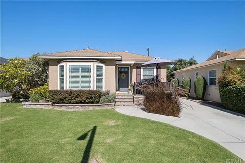 Photo of 6107 Greenmeadow Road, Lakewood, CA 90713 (MLS # OC21235532)