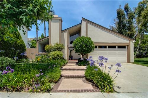 Photo of 42 Almond Tree Lane, Irvine, CA 92612 (MLS # OC21130536)