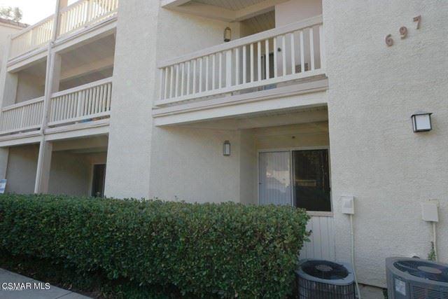 Photo of 697 Sutton Crest Trail #206, Oak Park, CA 91377 (MLS # 221002539)