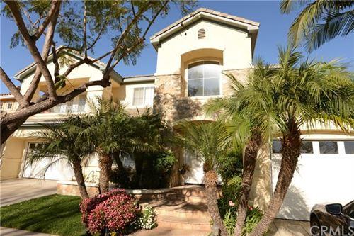 Photo of 75 Trailwood, Irvine, CA 92620 (MLS # OC21011543)