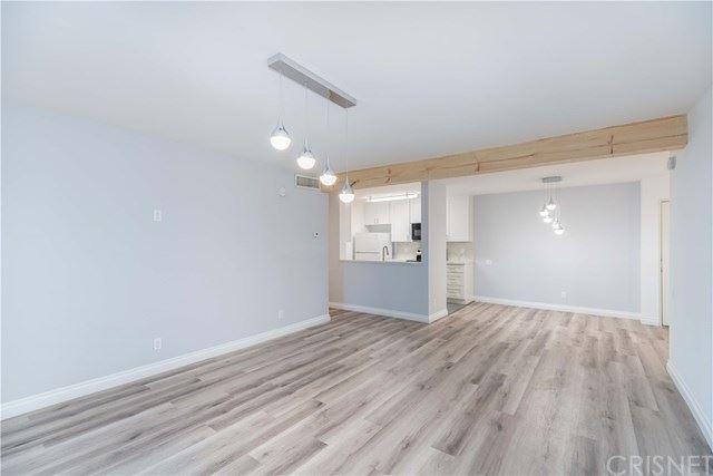 Photo of 5460 White Oak Avenue #J107, Encino, CA 91316 (MLS # SR21028550)