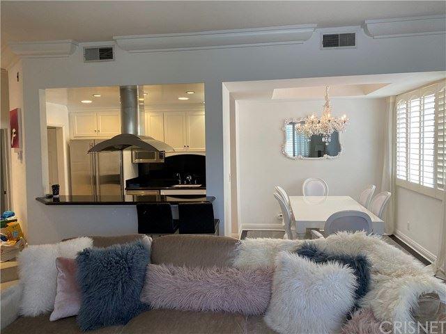 Photo of 315 N Swall Drive #303, Beverly Hills, CA 90211 (MLS # SR21093550)