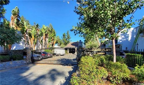Photo of 18645 Hatteras Street #101, Tarzana, CA 91356 (MLS # DW21226553)