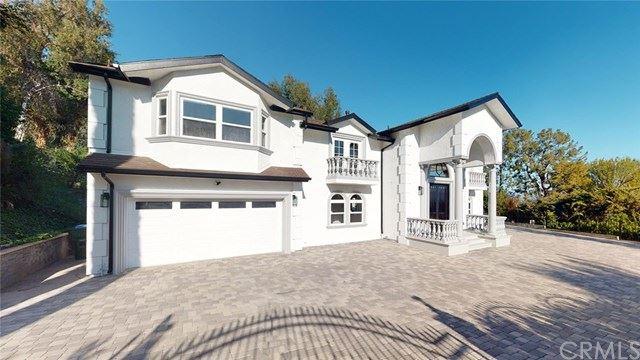 Photo of 4967 Bilmoor Avenue, Tarzana, CA 91356 (MLS # OC21074554)