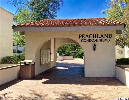 Photo of 25039 Peachland Avenue #202, Newhall, CA 91321 (MLS # SR21149556)