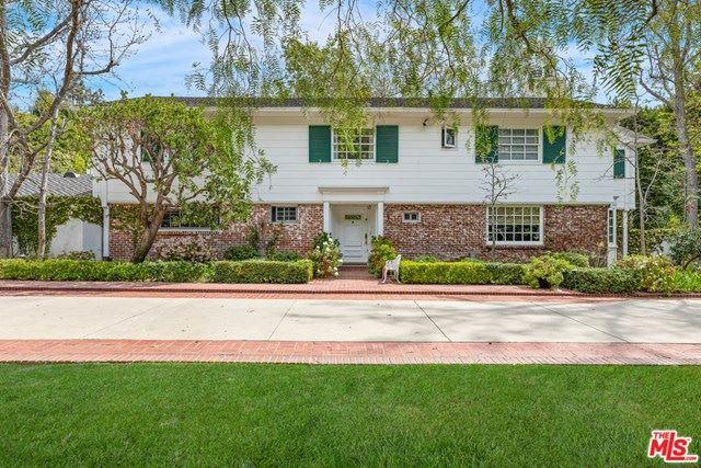 Photo of 1061 N Woodland Drive, Beverly Hills, CA 90210 (MLS # 21724562)