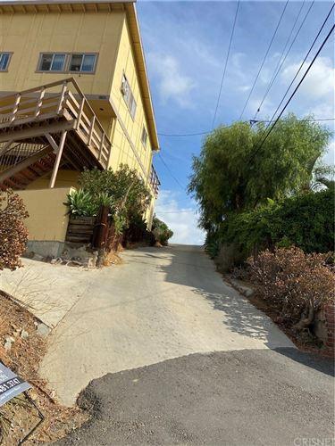 Photo of 11487 Aucas Drive, Chatsworth, CA 91311 (MLS # SR21234565)