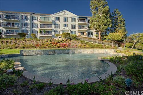 Photo of 200 Mcneil Lane #207, Newport Beach, CA 92663 (MLS # OC21041568)