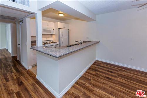 Photo of 18350 Hatteras Street #207, Tarzana, CA 91356 (MLS # 21798572)