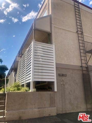 Photo of 18333 HATTERAS Street #124, Tarzana, CA 91356 (MLS # 19499576)