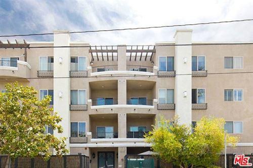 Photo of 1410 N CURSON Avenue #101, Los Angeles, CA 90046 (MLS # 20595578)