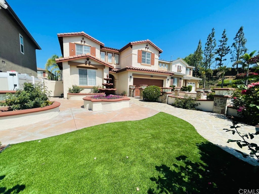 Photo of 8295 E Brookdale Lane, Anaheim Hills, CA 92807 (MLS # IV21161578)
