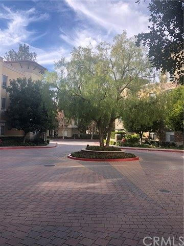 Photo of 24595 Town Center Drive #3112, Valencia, CA 91355 (MLS # PW20004589)