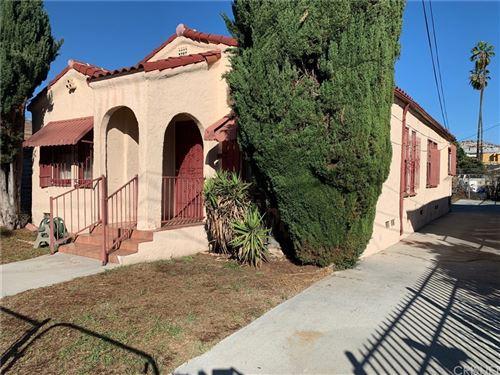 Photo of 3918 Walton Avenue, Los Angeles, CA 90037 (MLS # SR21236594)