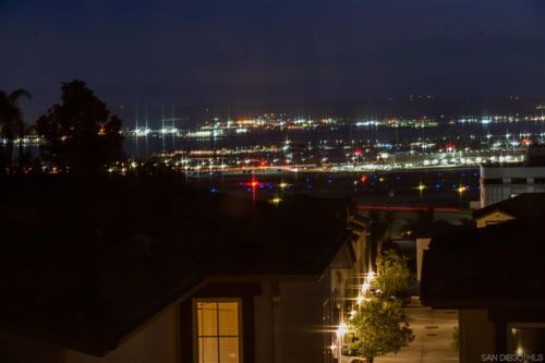 Photo of 3141 Harbor Ridge Ln, San Diego, CA 92103 (MLS # 210021596)