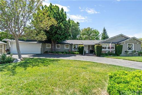 Photo of 6123 Woodlake Avenue, Woodland Hills, CA 91367 (MLS # SR20126598)
