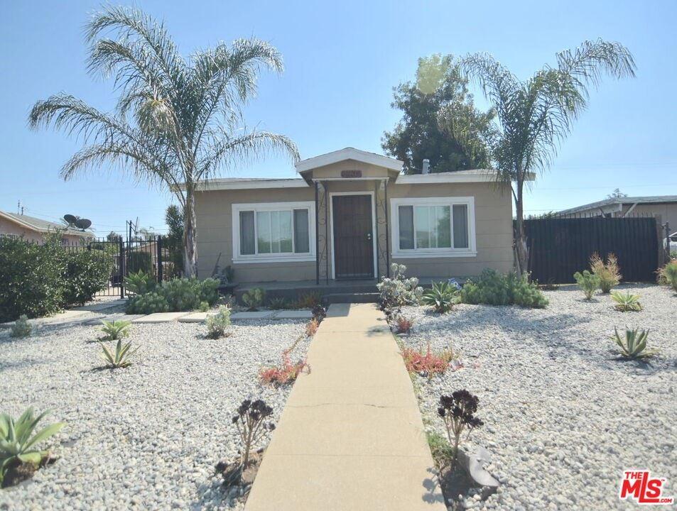 Photo of 1136 W 101St Street, Los Angeles, CA 90044 (MLS # 21796600)