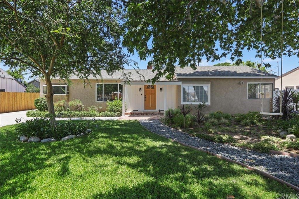 Photo of 7849 Paso Robles Avenue, Lake Balboa, CA 91406 (MLS # OC21160600)