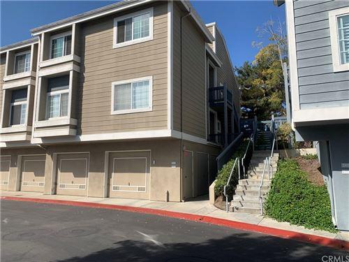 Photo of 20171 Sealpoint Lane #108, Huntington Beach, CA 92646 (MLS # OC21205611)