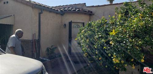 Photo of 2419 Carmona Avenue, Los Angeles, CA 90016 (MLS # 21697614)