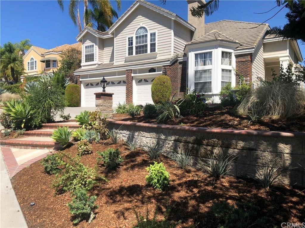 Photo of 27191 Woodbluff Road, Laguna Hills, CA 92653 (MLS # OC21213618)