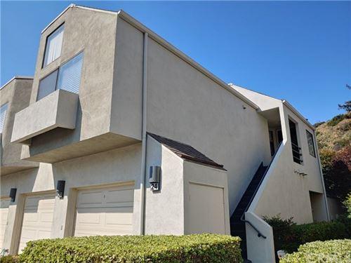 Photo of 5744 E Creekside Avenue #24, Orange, CA 92869 (MLS # PW20219623)