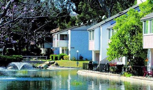 Photo of 24518 Nicklaus Drive #O7, Valencia, CA 91355 (MLS # SR21229628)