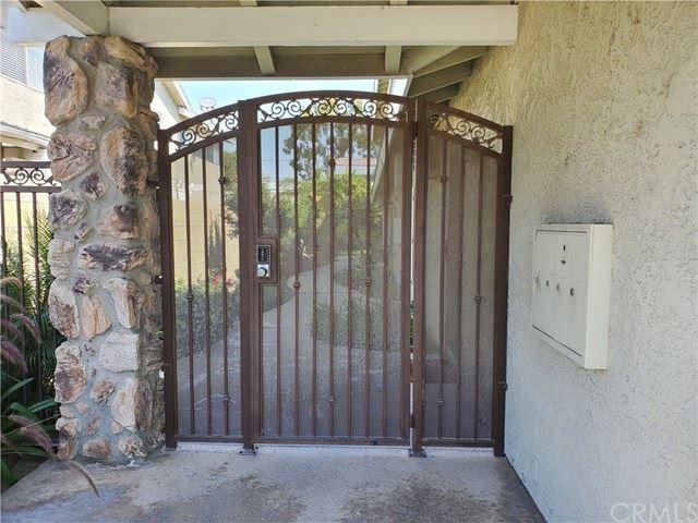 Photo of 4291 Green Avenue #4293, Los Alamitos, CA 90720 (MLS # PW21035631)