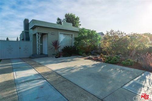 Photo of 1716 Leighton Avenue, Los Angeles, CA 90062 (MLS # 21715632)