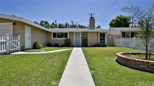 Photo of 27254 Crossglade Avenue, Canyon Country, CA 91351 (MLS # CV20135632)
