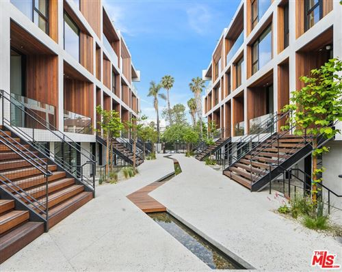 Photo of 610 S Van Ness Avenue #4, Los Angeles, CA 90005 (MLS # 21734634)
