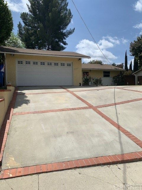 Photo of 20820 Clark Street, Woodland Hills, CA 91367 (MLS # SR21075640)