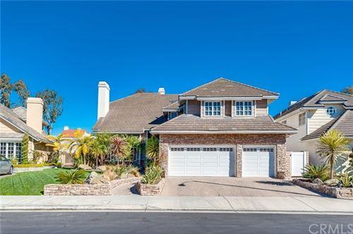 Photo of 4161 Shorebreak Drive, Huntington Beach, CA 92649 (MLS # OC21006644)