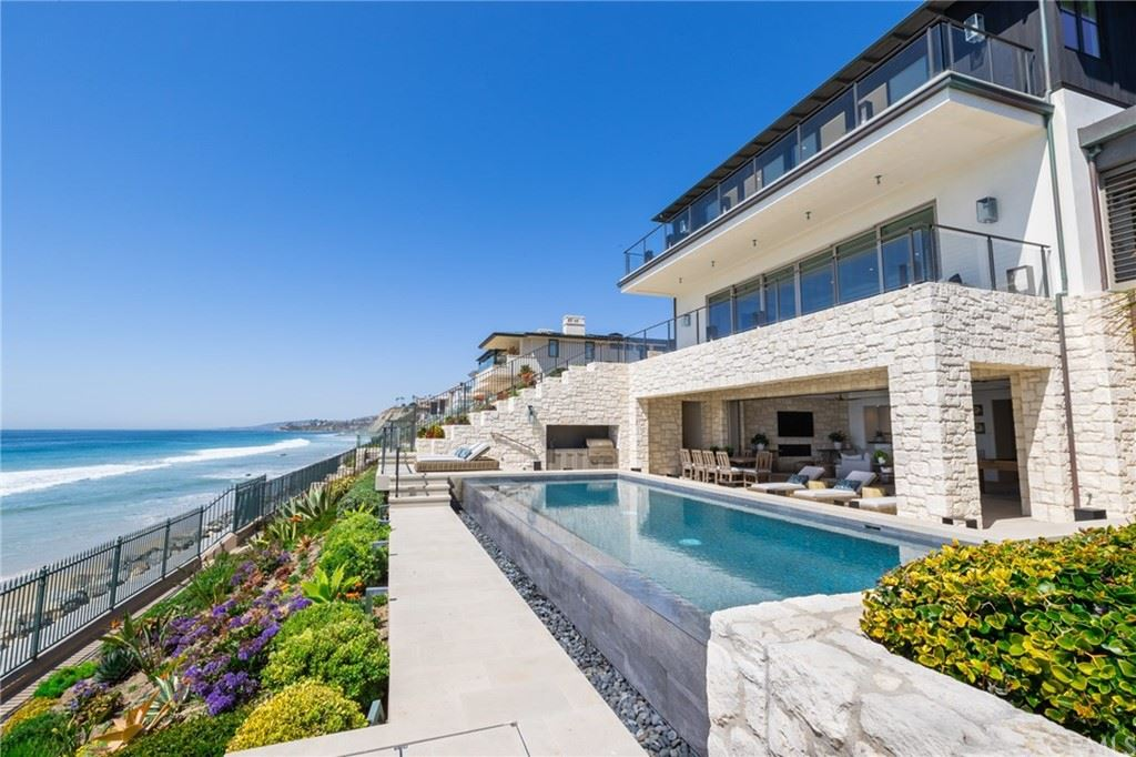 Photo of 39 Strand Beach Dr, Dana Point, CA 92629 (MLS # OC21060662)