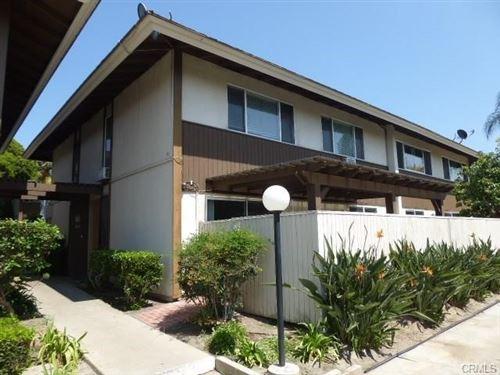Photo of 15500 Tustin Village Way #65, Tustin, CA 92780 (MLS # IV21191664)