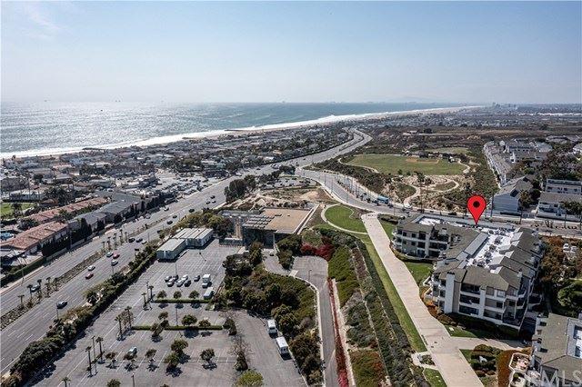 Photo of 200 Paris Lane #110, Newport Beach, CA 92663 (MLS # OC21087672)