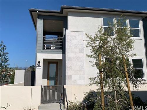 Photo of 385 Sawbuck, Irvine, CA 92618 (MLS # CV21064683)