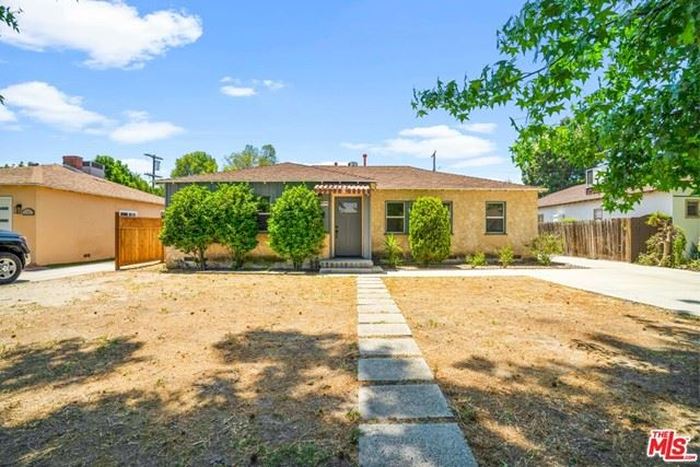 Photo of 12548 Martha Street, Valley Village, CA 91607 (MLS # 21745686)
