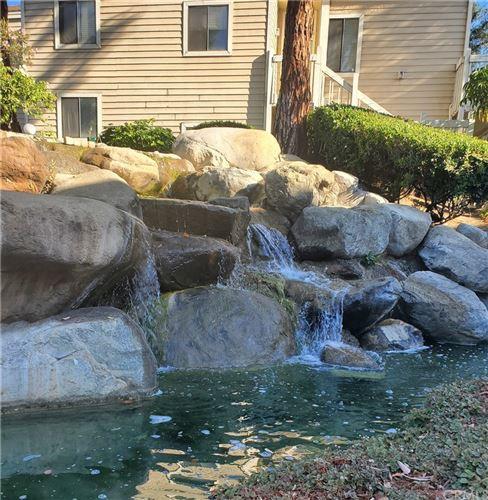 Photo of 4900 N GRAND AVE #315, Covina, CA 91724 (MLS # CV21224694)