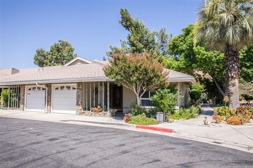 Photo of 26832 Circle Of The Oaks, Newhall, CA 91321 (MLS # V0-220005700)