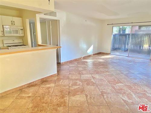 Photo of 18350 Hatteras Street #119, Tarzana, CA 91356 (MLS # 21677708)