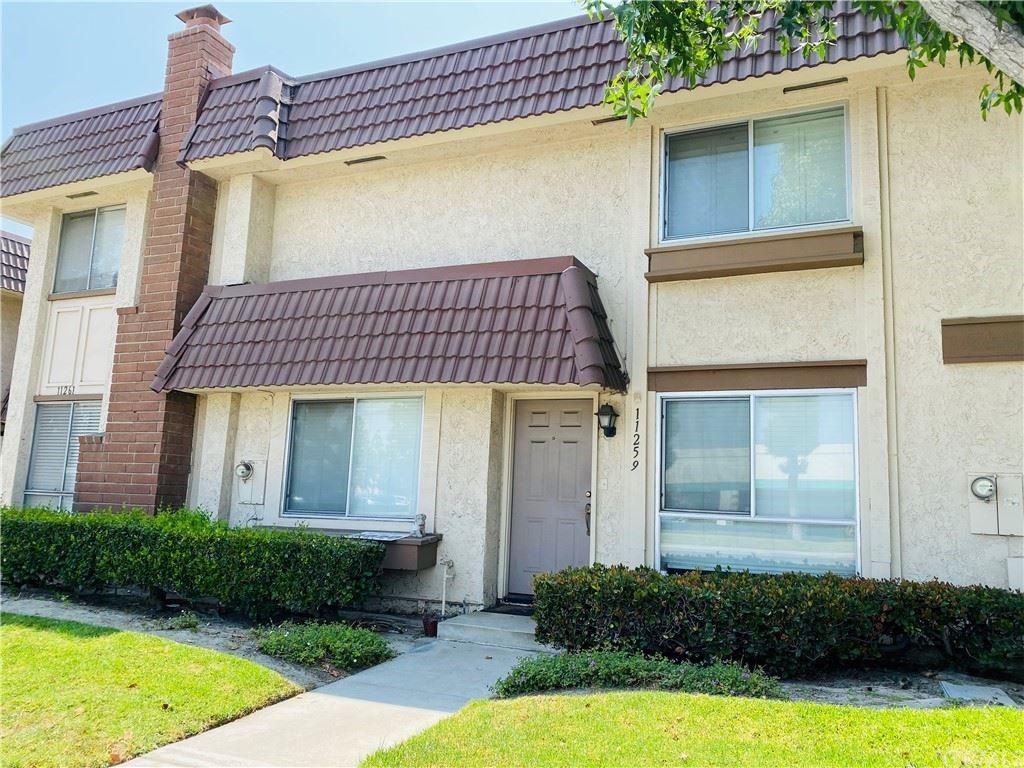 Photo of 11259 Knott Avenue, Cypress, CA 90630 (MLS # DW21147715)